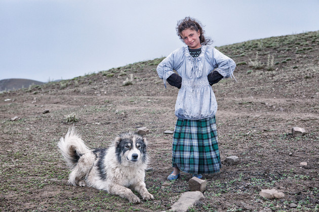 Kardelen and Her Dog. Dogs protect people at the highland against dangers. Van, Turkey. July 2012.