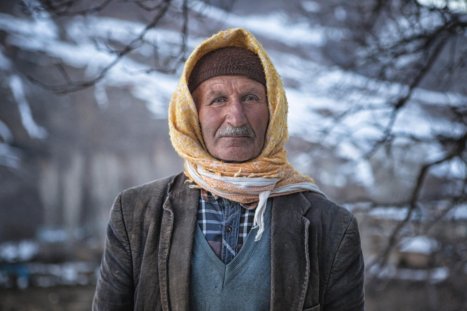 The Villager in Yellow Hood. Alacayar, Van. February 2017.