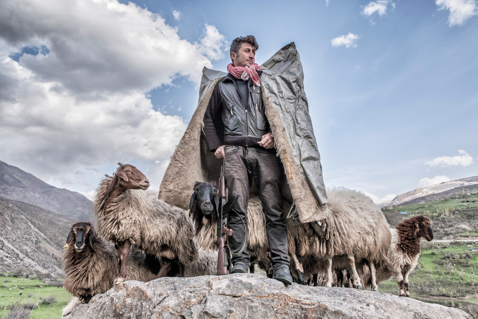 Shepherds wear felt cloaks to protect themselves from the cold. In addition, they carry guns to protect themselves from animal predators. Alakaynak, Van. April 2015.