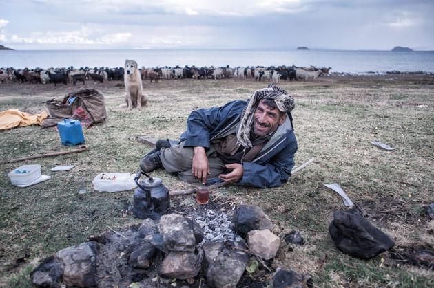 Salih gives a tea break near Lake Van to relieve his tiredness. Van, Turkey. September 2011.