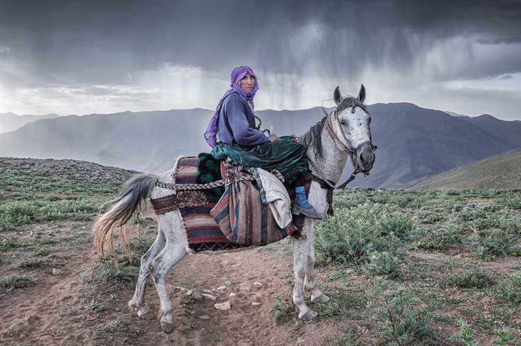 Mother Halime. She returns home after milking in the village of Alacayar. July 2017.