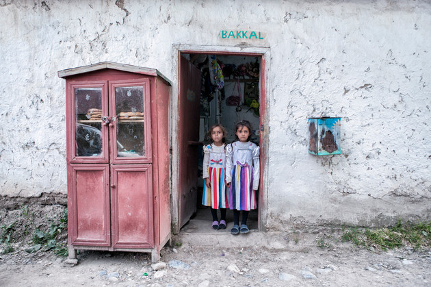 Twins in Colors. They are at the village market to buy ice cream. Van, Turkey. July 2013.