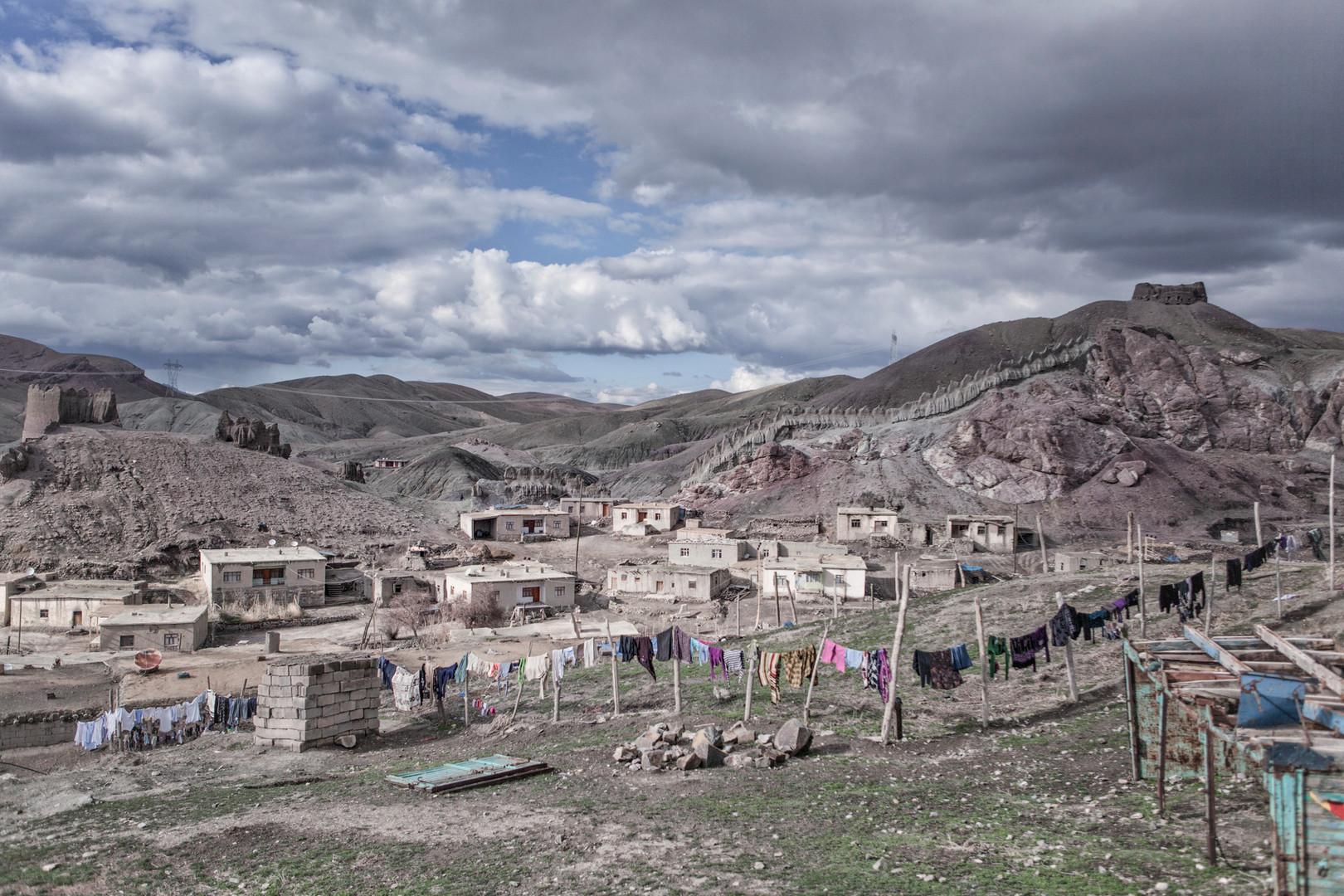 Although reinforced concrete houses became widespread in villages, adobe houses still exist. Hosap, Van. April  2011.