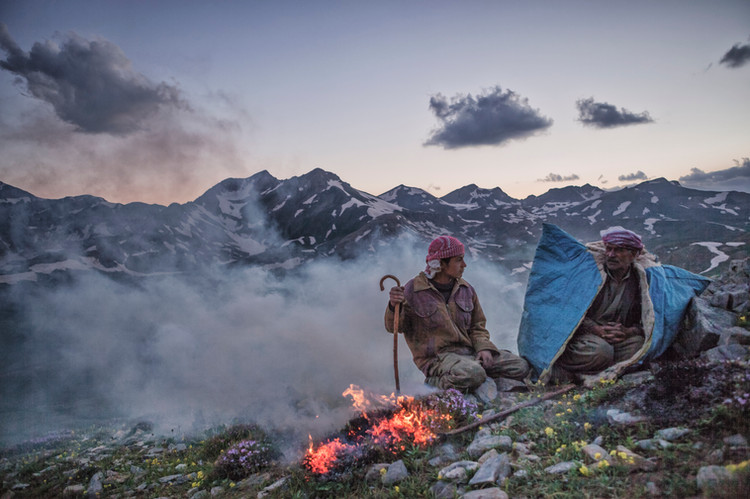 As the nomads put the herd out to grass, they try to warm up at the same time by burning the bushes. Nomads often stop over in Van's cool highlands. They come to Van with their animals from hot provinces in the southeast to spend four months here each year. Van, Turkey. June 2012.