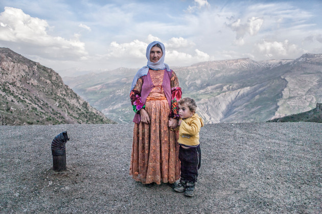 The Mother and Daughter. They are at the roof of an adobe house. Van, Turkey. May 2013.