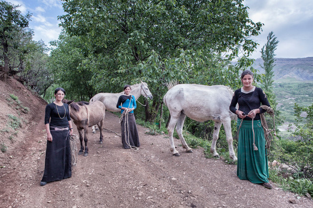 Sisters take the horses out to feed. Van, Turkey. May 2013.