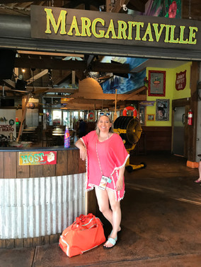 Christina at the Margaritaville on Paradise Island in the Bahamas waiting for our Hidden Beaches Tour to swim with the pigs