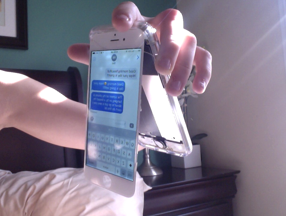 Kaitlynn Stone with a broken iphone screen falling off