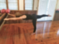 Kelly at the barre leg extended to the b