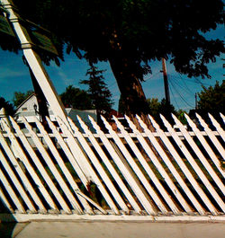 chipped/bent white fence