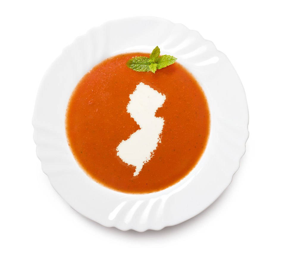 A plate tomato soup with cream in the sh