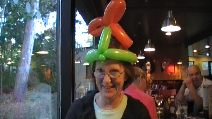 Mum in balloon modelling hat