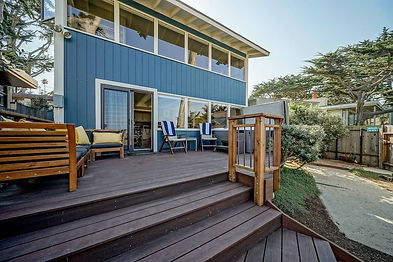 This charming beach house located on the coveted Scenic Road in Carmel-by-the-Sea offers striking ocean views of Carmel Beach and Pescadero Point. Enter into a large kitchen sharing a corner fireplace with the cozy ocean view living and dining room. The upper level is dedicated to the expansive primary suite offering panoramic ocean views with built-in desks and a reading nook. This 4,600 sq.ft. street-to-street lot presents 800 sq.ft. of entertaining areas including a hot tub, outdoor shower for beach days, and a tall fence to provide privacy while still being able to enjoy the vast views. For the first time in 70 years, this perfect beach getaway could be yours.