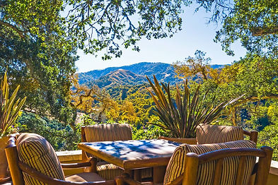 Live amongst the heritage oaks with redwood and ridgeline views, just a short stroll to the nature community's social heartbeat at The Preserves Ranch Club and 15 minutes to Carmel restaurants and schools. Enjoy year-around Mediterranean climate in the sun on this very private 53-acre property with recreation amenities and resident services at your fingertips, including a Tom Fazio Design, Top-100 Rated 18 hole golf course. This single-level 4 bedroom, 4.5 bath Spanish hacienda embraces indoor and outdoor living in the traditional courtyard, viewing deck and screened-in porch. Its seamlessly open living spaces in the central great room and kitchen are perfect for entertaining, while the more intimate master suite and guest wings provide privacy. The attached caretakers house with separate entrance is perfect for friends' extended stays. Enjoy the sun and privacy in the oaks and relax by the fireplace after hiking or riding one of the many Santa Lucia Preserve trails.