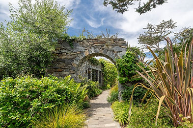 Privately sited on 8 lots on highly coveted Carmel Point, this grand stone estate was recently built with exquisite craftsmanship and attention to detail and is without parallel in Carmel. The main house boasts an expansive master suite, office, living room, spacious open kitchen and family room, 2 guest suites, a light-filled gym and 2 car garage. Additionally, guests can enjoy a serene stroll through the private gardens and water features to the guest house and art studio. All 5,710 sq.ft. of this residence is on a single level, making for an elegant and comfortable retreat for family and guests.   Located within 3 blocks of both Carmel and River Beaches this estate offers a truly unique combination of location, quality, size, character and privacy.