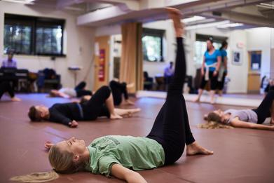 Floor work in modern class at Hixon Dance