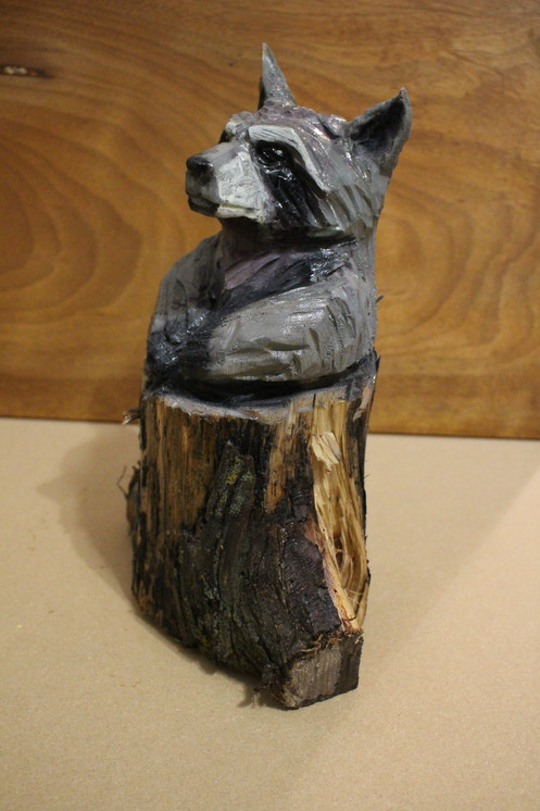 1ft. raccoon in a stump chainsaw carving