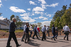 A group of people walking outside, during a housing charrette