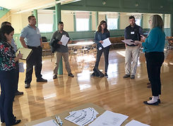 Group of peole talking during a housing charrette.