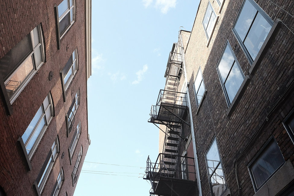 View looking up at the exterior of apartment buildings