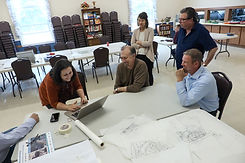 Group of people looking at maps during a housing charrette.