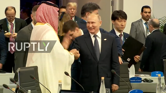 Putin's bro-five with Saudi crown prince reveals the G20's diplomatic dance