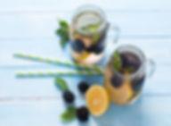 Blackberry and Lemon Detox in jars with straws.