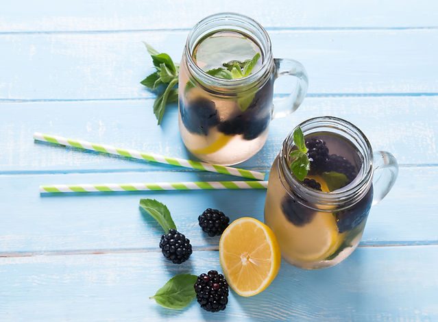 Blackberry and Lemon Detox in jars with straws.