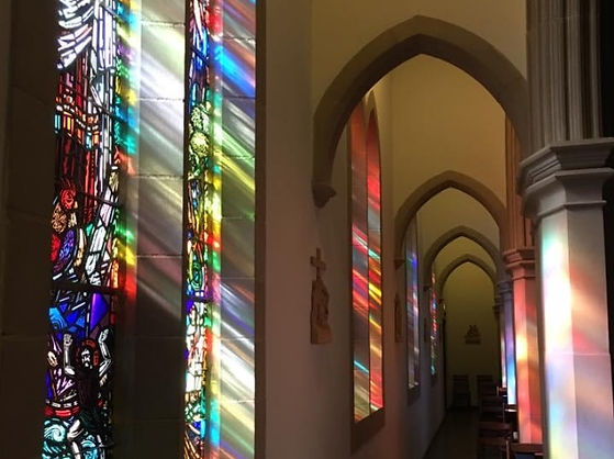 All Saints' Stained Glass near pillars.j