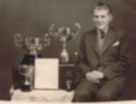 Derek Myers with awards.jpg