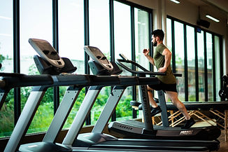 man running on treadmill, fitness