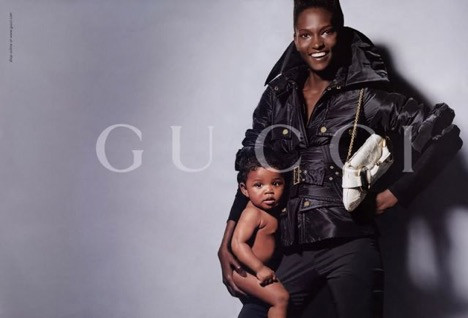 Nadine Willis posing for Gucci with her youngest daughter