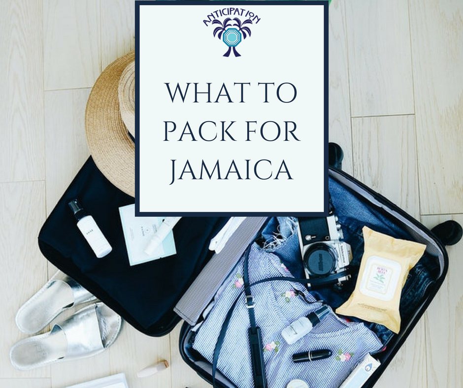 """Open, partially packed suitcase with blog post title """"What to Pack for Jamaica"""""""
