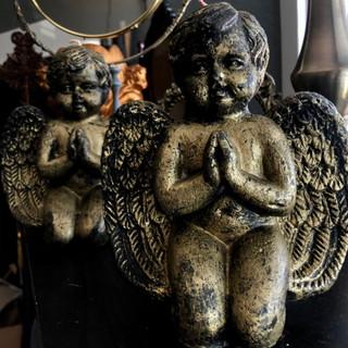 Two unique cherub candles