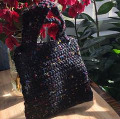 Black and rainbow hand bag