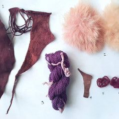 The Urine Trials is a project begun 2016-present, to create lasting purple dye using only local lichens and urine.   In this photo, #1 is buckskin dyed with an Umbicularia sp. in commercial ammonia solution made by weaver Louise Wheatley. #3 is wool dyed by Sam Feld of The Mushroomworks with a Punctelia sp. in commercial ammonia. #2, #4, #5, & #6 are dyed with a Punctelia sp. in urine by Victoria. #2 is samples of sumac tanned rabbit fur hides dyed without heat in a young developing dye bath. #4 is buckskin. #s 5 & 6 are wool dyed without heat.  These samples from Spring 2020