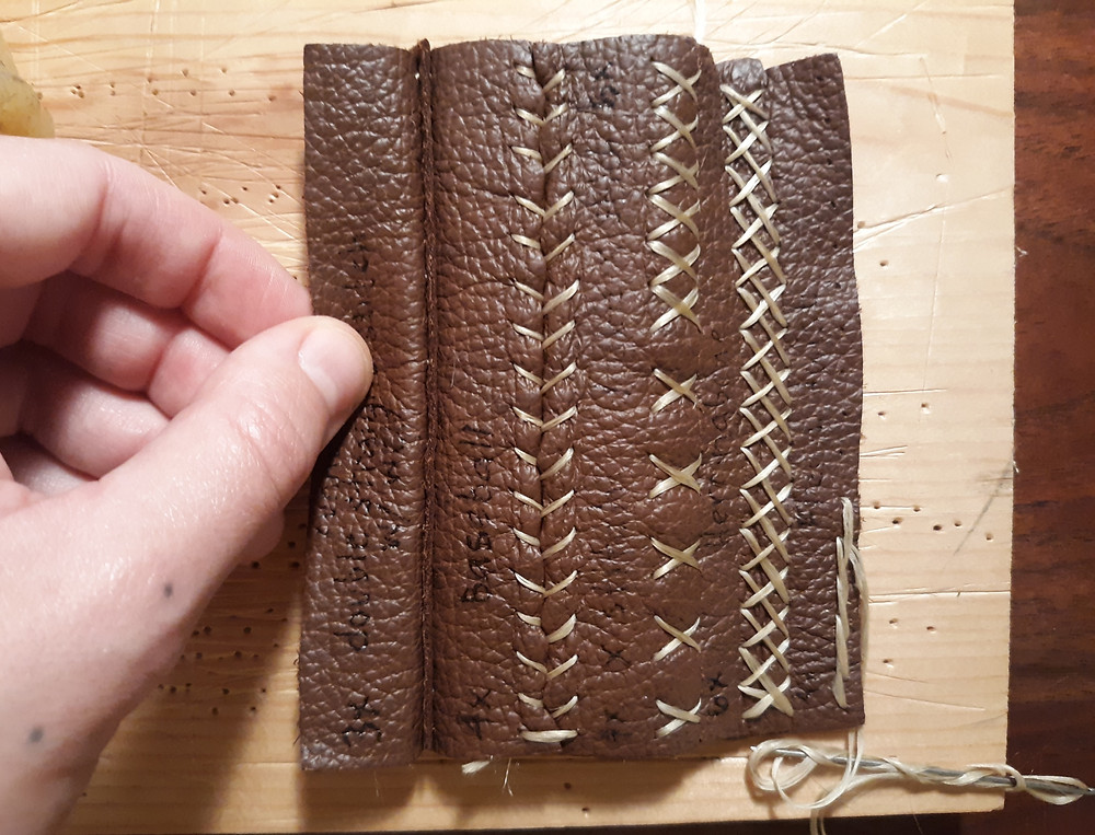 Leather stitching taught by Charity Cimarron, photo by Victoria Greba