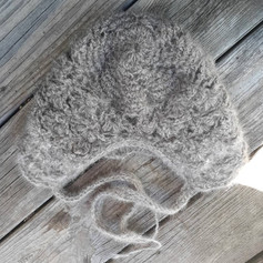 (back) Crochet possum fur sleeping bonnet. Made with about 438 ft of 2-ply yarn, hand spun by drop spindle. This is about 4 possum's worth of fiber.  2021