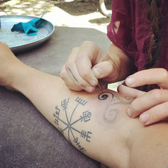 Previous triskelion during tattooing.