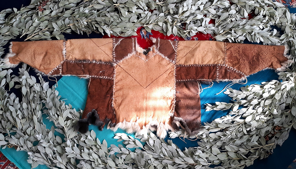 sumac vegetable tanned domestic rabbit fur hide long sleeve garment natural leather bark tanning buckskin stitching by Victoria Greba
