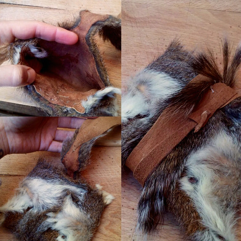 This precious pouch is made from one vegetable tanned, hair-on squirrel hide, folded into a square, and stiched nearly invisibly with deer sinew thread.   No cuts were made in this hide.  The ultra thin & delicate tail was reinforced with a strip of deer buckskin dyed with black walnut, which serves as the wrap-around closure.   Made 2017