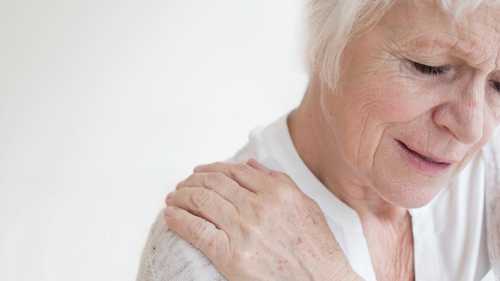 older woman with shoulder arthritis