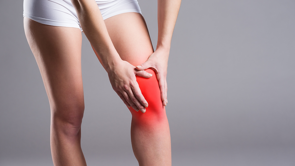 woman with hands on knee showing red for inflammation