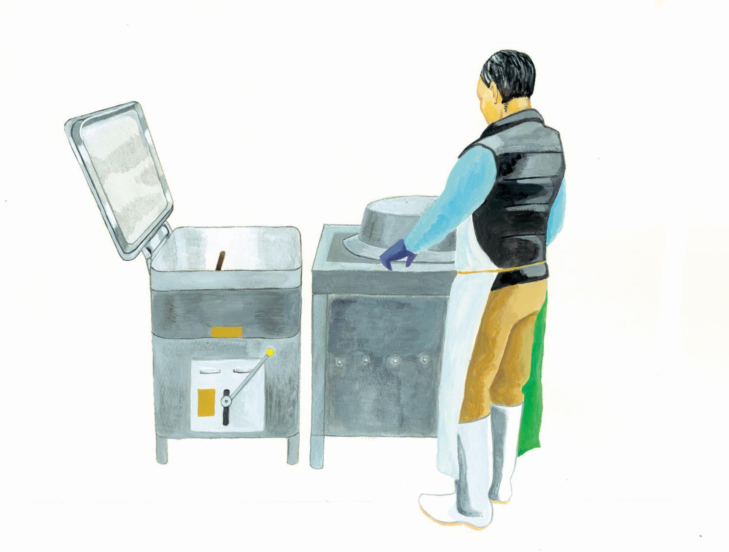 この機械で砕いた大豆を煮て、プレスして豆乳にする