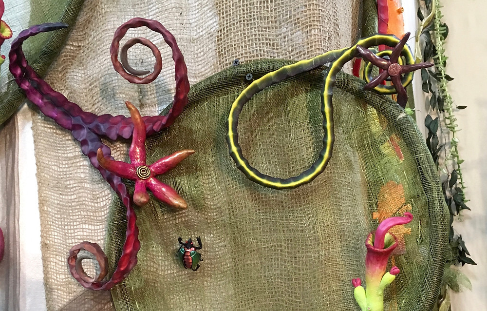Polymer clay tendrils by Maggie Maggio