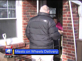 Service workers brave bitter cold to deliver meals to elderly and disabled