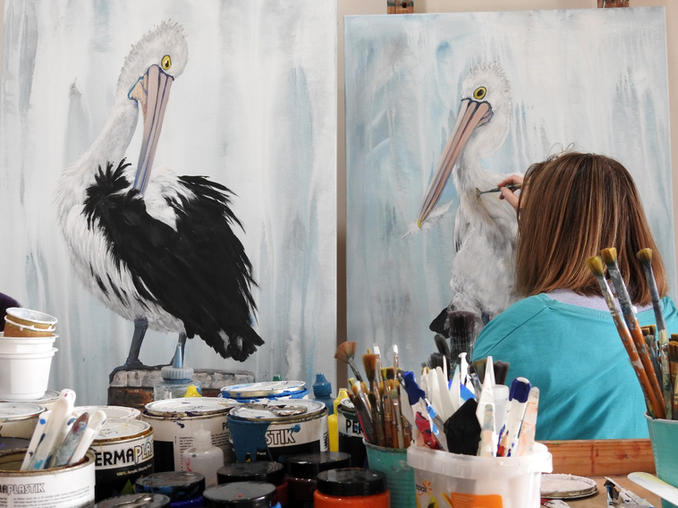 Artist Naomi Veitch painting pelicans in 2021