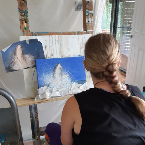 student painting in a private art lesson