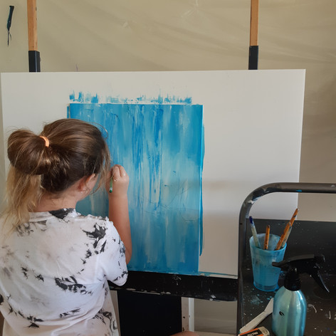 Student painting in art class