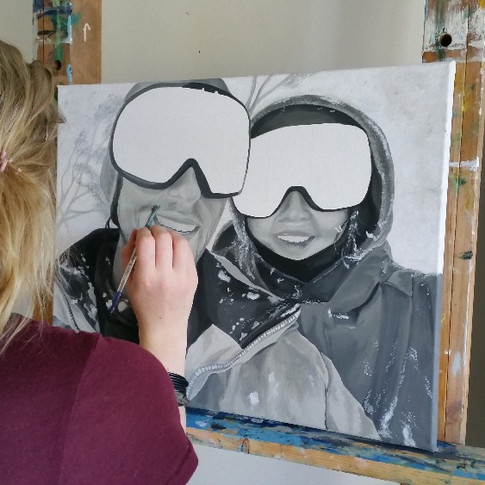 student painting in an art class